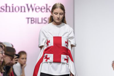 a shirt from the situationist label collection featuring the georgian flag photo from mercedes benz fashion week tbilisi