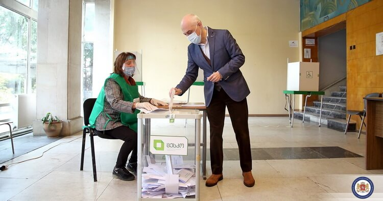 Georgian ruling party leads in polls as opposition cries foul