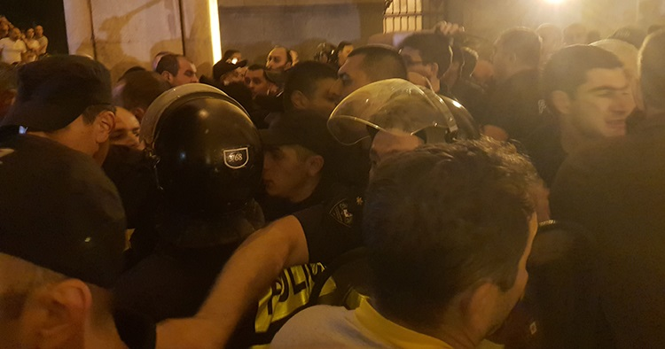 Georgians call for snap elections in second night of protests